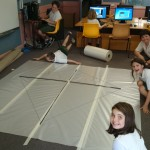 Taping the plastic sheets together was a huge task. We needed all hands on to put it together.